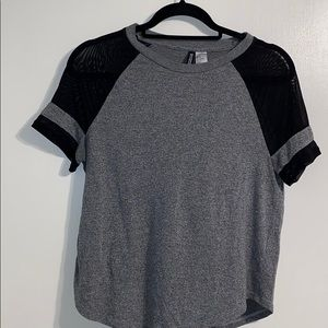 Adorable short sleeve top with mesh lining